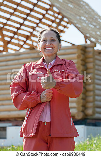 Happy  woman against  building residence - csp9930449