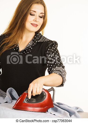 Happy woman doing ironing - csp77063044