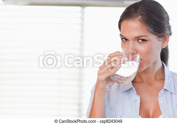 Happy woman drinking a glass of water - csp8243049