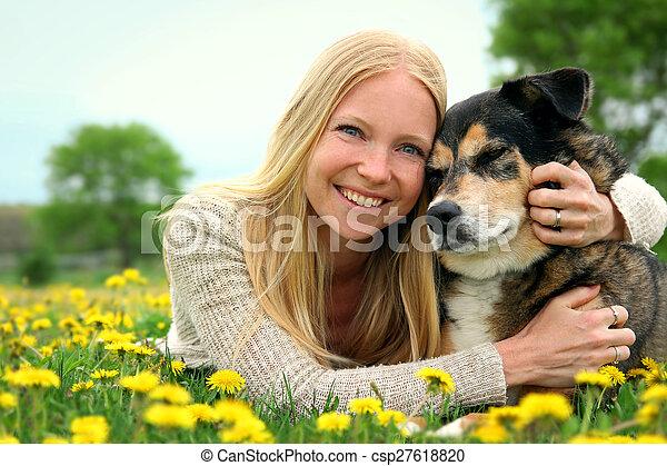 Happy Woman Hugging German Shepherd Dog - csp27618820