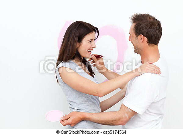Happy woman hugging her boyfriend after drawing a heart - csp5174564