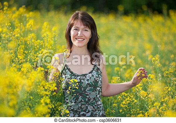 happy woman in field - csp3606631