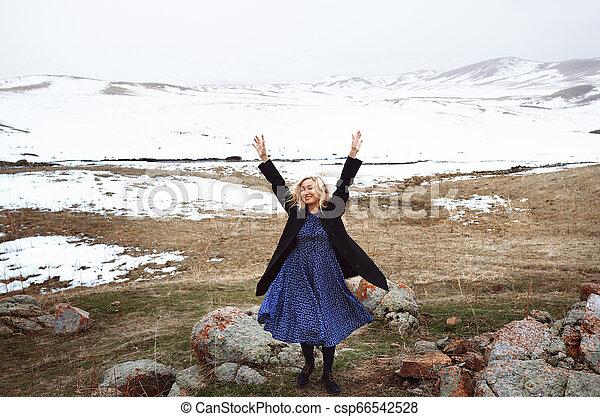 Happy woman in the winter landscape - csp66542528