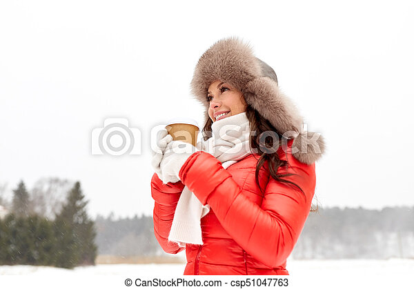 781df6ac5c783 Happy woman in winter fur hat with coffee outdoors. People, hot ...