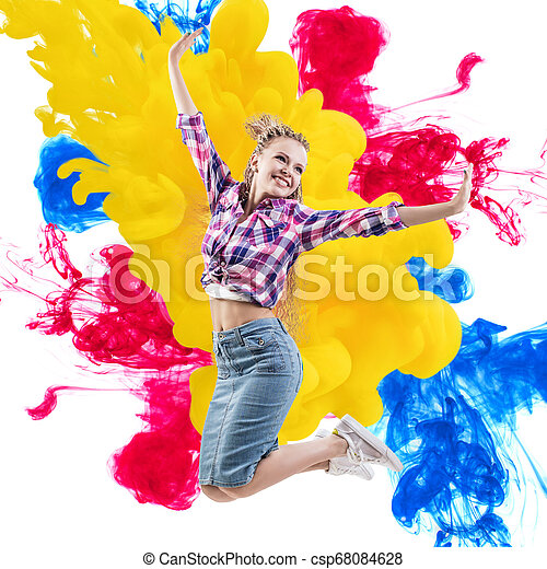 Happy woman jumps over paints explosion background. - csp68084628