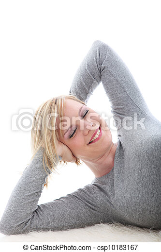 Happy woman lying on white background - csp10183167