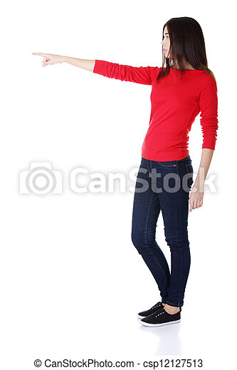 Happy woman pointing on copy space - csp12127513
