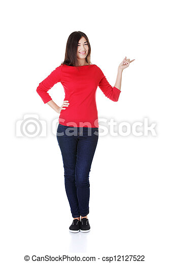 Happy woman pointing on copy space - csp12127522