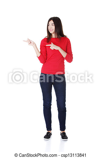 Happy woman pointing on copy space - csp13113841