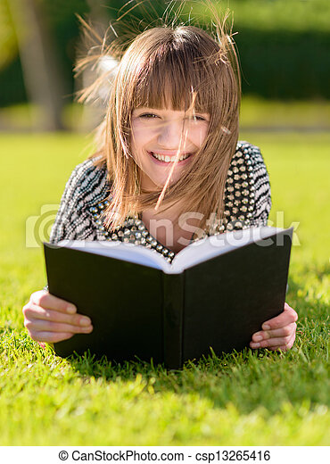 Happy Woman Reading Book In Park - csp13265416