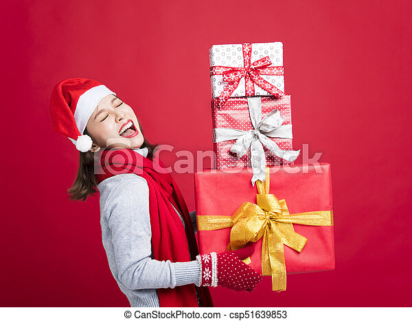 happy Woman shopping for christmas gifts - csp51639853