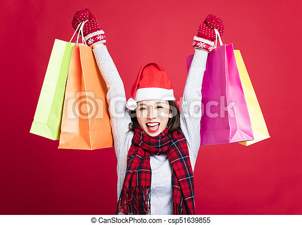 happy Woman shopping for christmas gifts - csp51639855