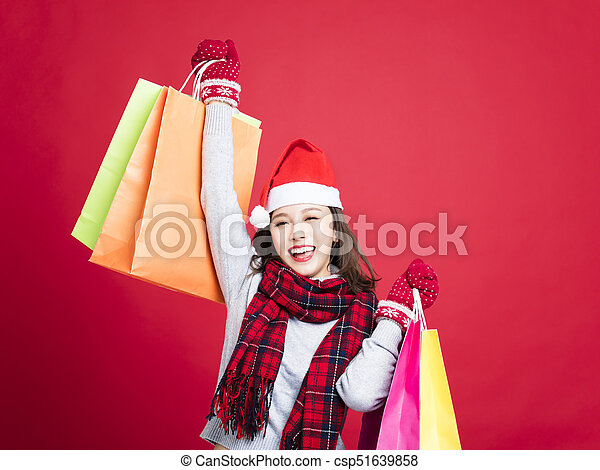 happy Woman shopping for christmas gifts - csp51639858