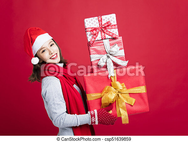 happy Woman shopping for christmas gifts - csp51639859
