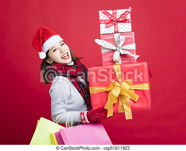 happy Woman shopping for christmas gifts - csp51611923