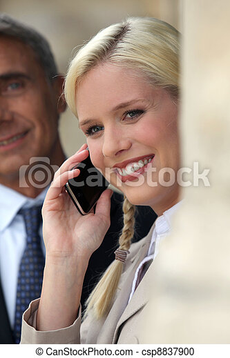 Happy woman using a mobile phone - csp8837900