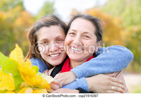 Happy   woman with adult daughter   - csp21916397