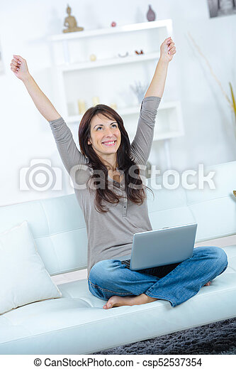 happy woman with arms up and laptop - csp52537354