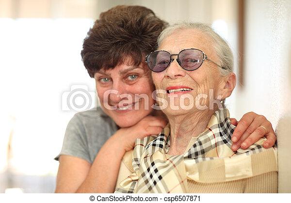 Happy woman with elderly mother - csp6507871