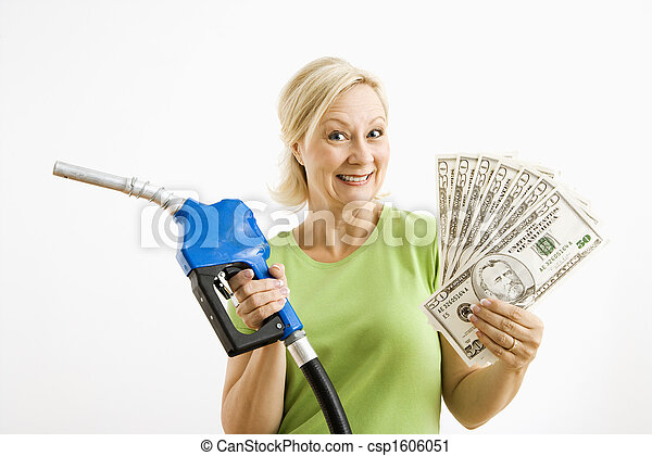 Happy woman with gas pump and money. - csp1606051