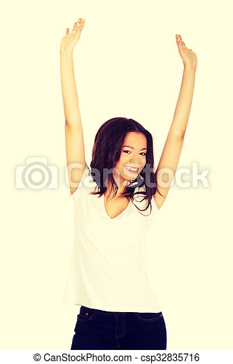 Happy woman with hands up. - csp32835716