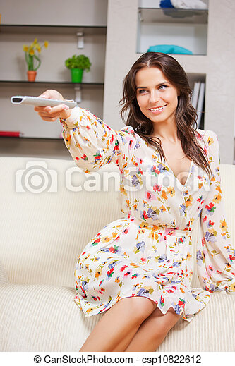 happy woman with TV remote - csp10822612