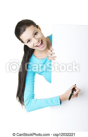 Happy woman writing with a pen on blank board. - csp12032221
