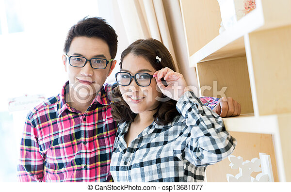 Happy Young adult Couples in living room - csp13681077