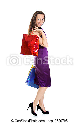 Happy young adult woman with colored bags  - csp13630795