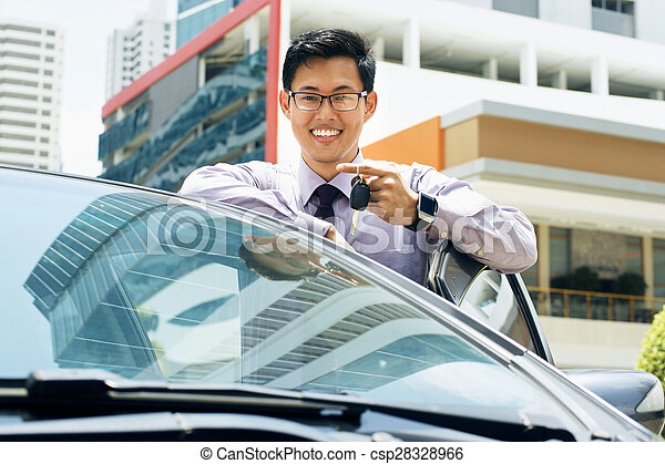 Happy Young Asian Man Smiling Showing Keys Of New Car - csp28328966
