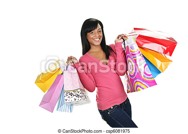 Happy young black woman with shopping bags - csp6081975
