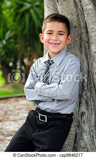 Happy Young boy in business attire - csp9846217