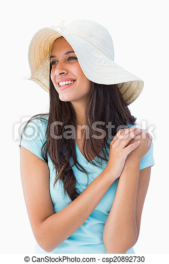 f4bcc5a0 Happy young brunette wearing sunhat on white background.