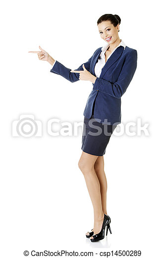 Happy young business woman pointing on copy space - csp14500289