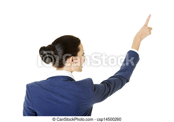 Happy young business woman pointing on copy space - csp14500260