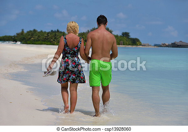 happy young  couple at summer vacation have fun and relax at beautiful sunny  day on beach - csp13928060