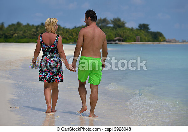 happy young  couple at summer vacation have fun and relax at beautiful sunny  day on beach - csp13928048