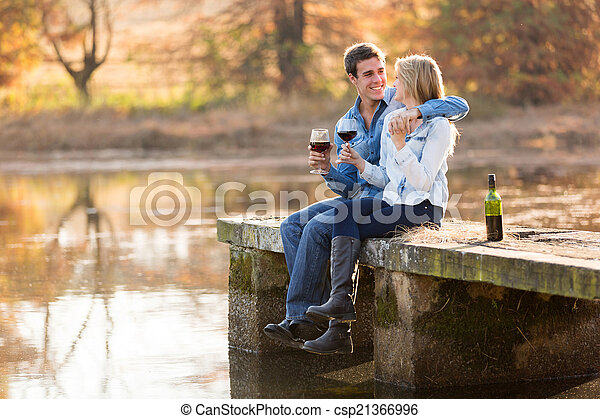 happy young couple drinking red wine - csp21366996