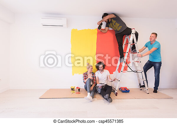 Happy young couple relaxing after painting - csp45571385
