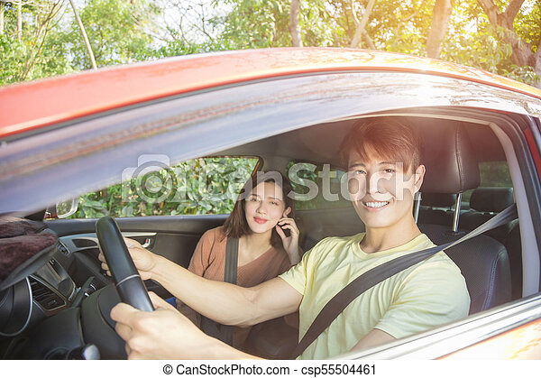 happy young couple sitting in the car - csp55504461