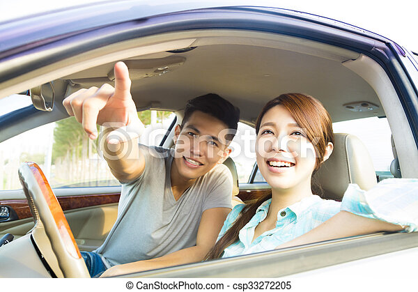 Happy Young Couple Sitting In the Car - csp33272205