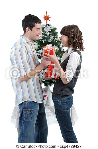 happy young couple with christmas gifts csp4729427