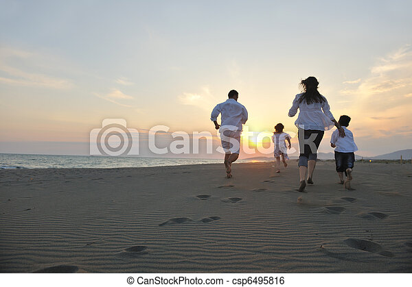 happy young family have fun on beach at sunset - csp6495816