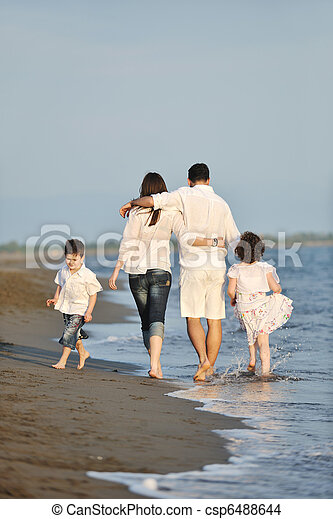happy young family have fun on beach at sunset - csp6488644