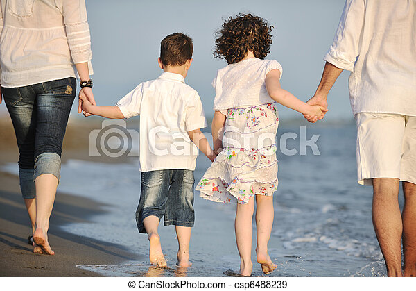 happy young family have fun on beach at sunset - csp6488239