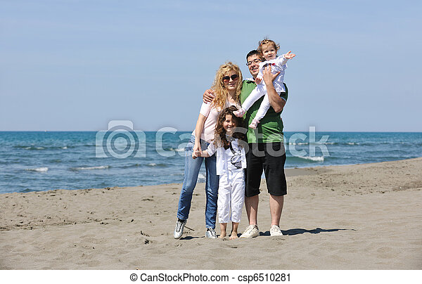 happy young family have fun on beach - csp6510281