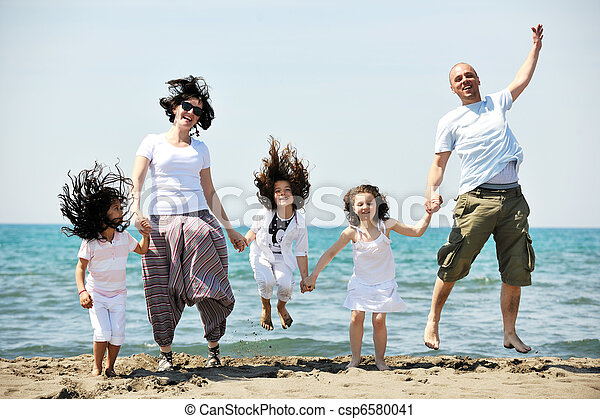 happy young family have fun on beach - csp6580041