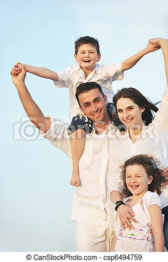 happy young family have fun on beach - csp6494759