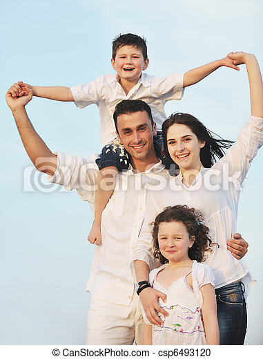 happy young family have fun on beach - csp6493120