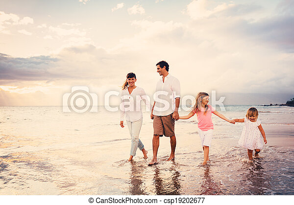 Happy Young Family have Fun Walking on Beach at Sunset - csp19202677